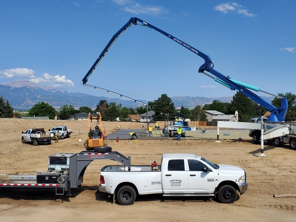 Concrete being poured for basketball courts.