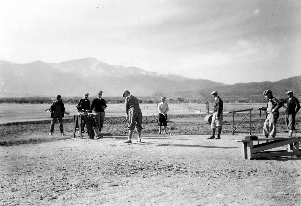 Historic photo of golfers playing at Patty Jewett with Pikes Peak in the background