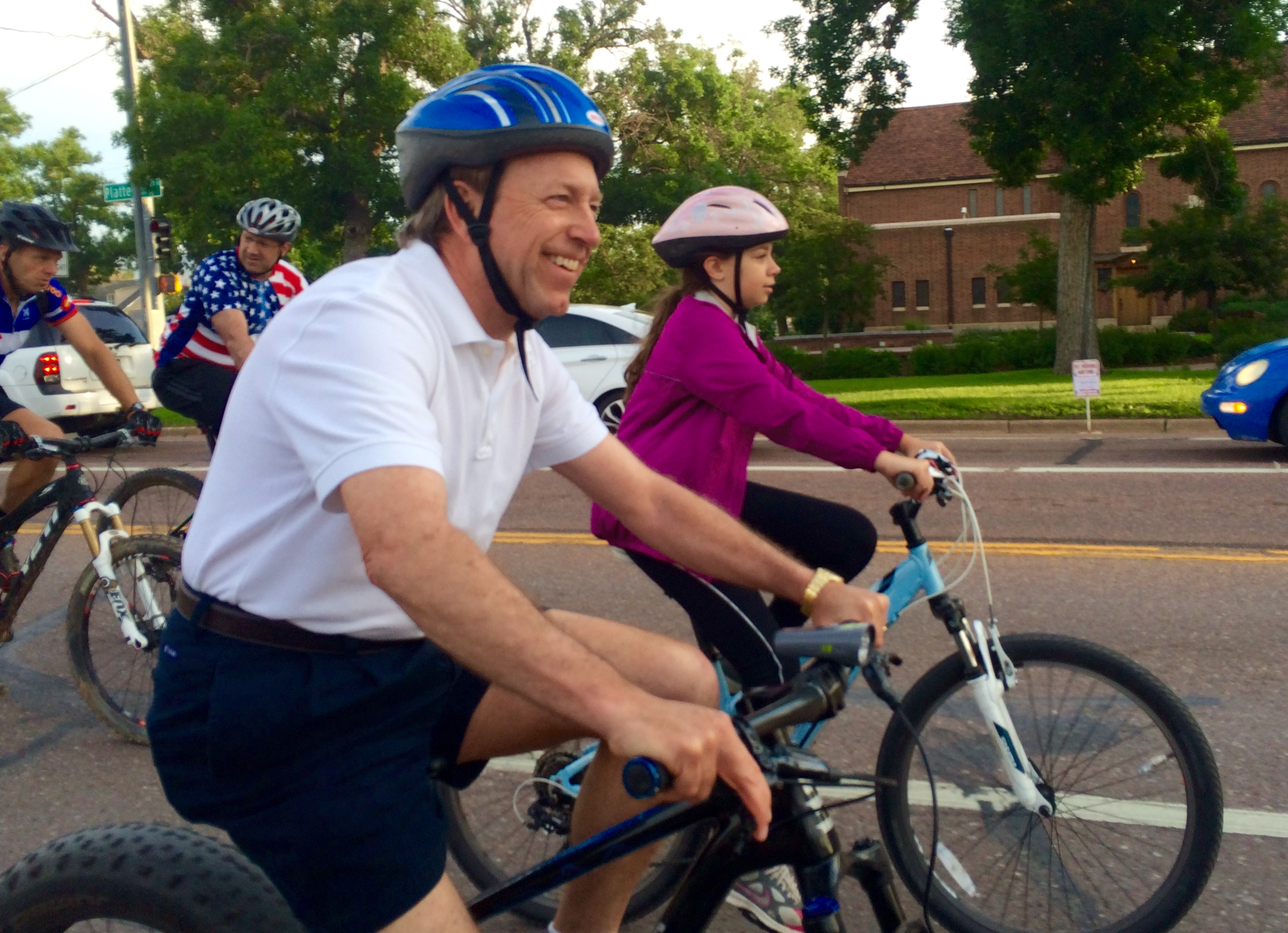 Mayor John Suthers riding a bike on bike to work day in 2016