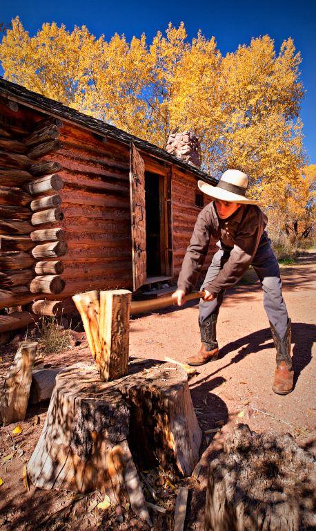 Man splitting wood with an ax