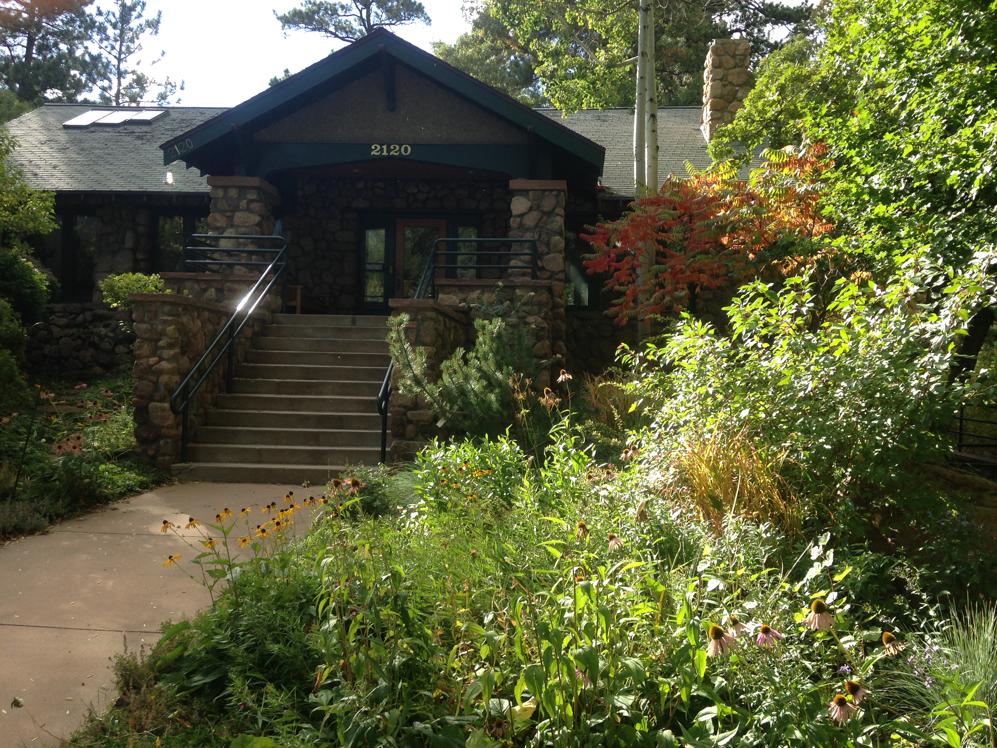 Starsmore Discovery Center is housed in a log cabin surrounded by greenery at North Cheyenne Canyon Park