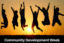 "Silhouette of six people jumping with the sun setting behind them in a golden sky. text says ""community development week'"
