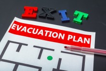 Worksheet with the words 'evacuation plan' at the top, block letters above the page spell 'exit'