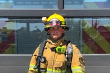 fire fighter in structure firefighting gear