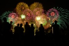 people watching a fireworks show