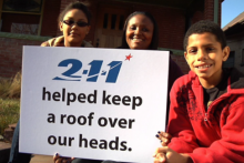 photo has text that says 2-1-1 helped keep a roof over our heads.