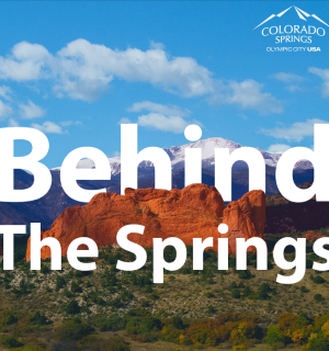 "garden of the gods and pikes peak with text over photo that says ""behind the springs."""