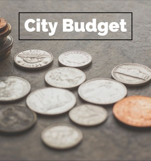 "photo of coins and text that reads ""city budget"""