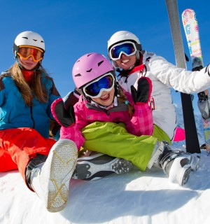 Girls wearing winter ski gear and helmets