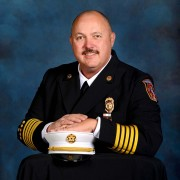 Official Colorado Springs Fire Department headshot of Chief Ted Collas in his dress blues