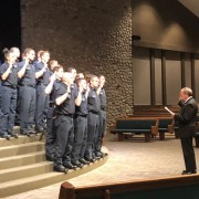firefighters raise their right hand as they are sworn into office by Mayor John Suthers