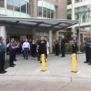 officers line up outside of Craig Hospital to support officer Duzel as he leaves.