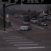 red light camera photo of stolen car running red light on right-hand turn