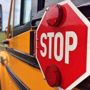 side of school bus with closeup of bus' stop sign