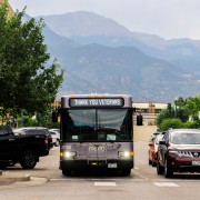 front of bus with pikes peak in background