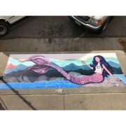 mermaid painting over storm drain
