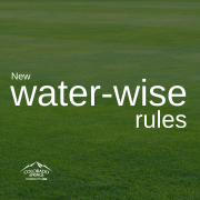 field of green grass. new water-wise rules. city logo