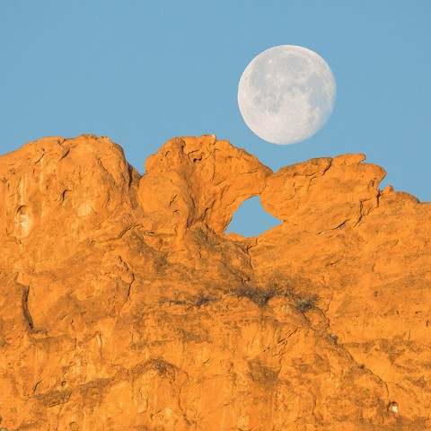 Placeholder image. Close up of Kissing Camels rock formation under a full moon