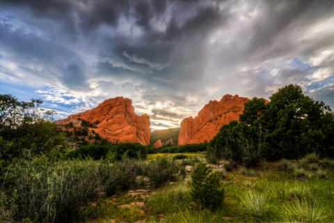 Garden of the Gods rock formations with clouds and sun