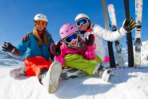 Girls wearing winter ski gear and helmets