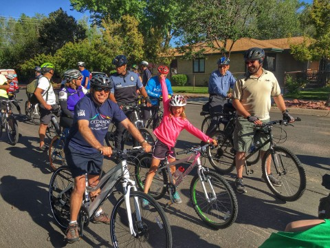 Mayor John Suthers riding a bike during the Mayors Ride event