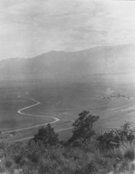 photo from 1903 shows Paseo drive connecting the city to the park, with a coal mining operation and powerplant on the right of the image.