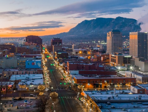 aerial view of downtown colorado springs at night. mountains in the background