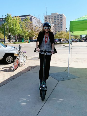 person riding scooter downtown