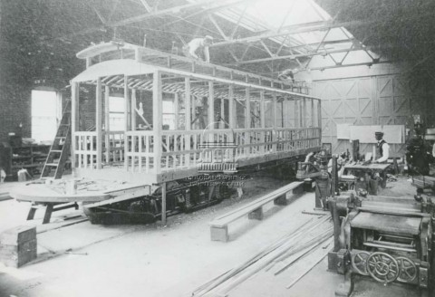 historic photo of trolley inside a maintenance building.