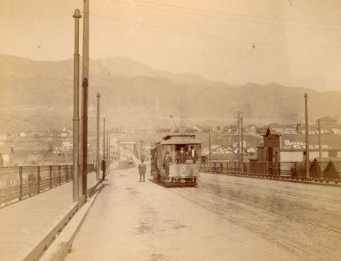 historic photo in sepia tones of a trolley with pikes peak in the background