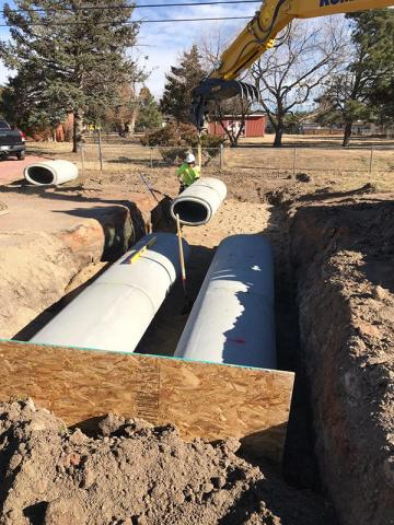 photo of large cement cylinders for drainage system