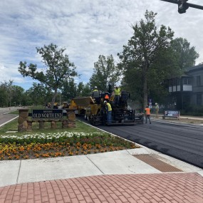 new pedestrian ramp and pavers in the background