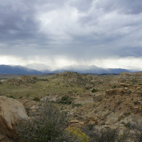 Storm rolling in over rocky landscape