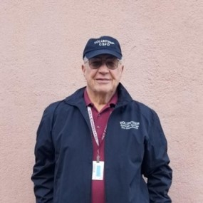 This volunteer uniform consists of khakis, maroon polo shirt and navy baseball cap and navy wind jacket