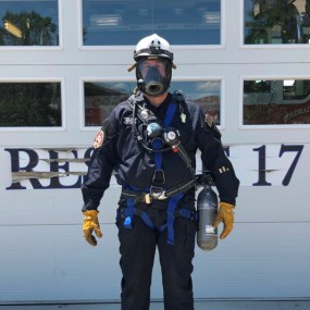 confined space uniform includes helmet, breathing apparatus, gloves