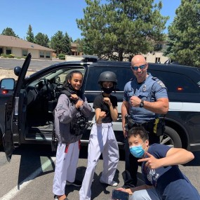 kids try on some police helmets and vets
