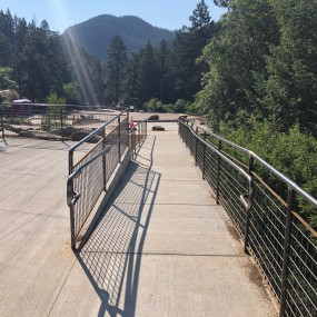 ramp from parking lot to viewing platform. Mountains in the background.