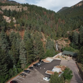 aerial view of helen hunt falls and parking area. A patch of new pavement is visible where ADA accessible parking spaces have been added.