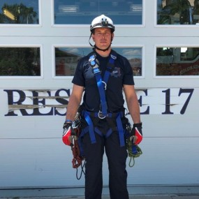 high angle rescue uniform includes helmet and climbing gear