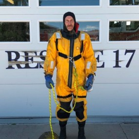 ice rescue uniform is a yellow dry suit with flotation device