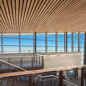 Two level viewing area inside the visitor center. Windows are floor to ceiling on three sides of the room.