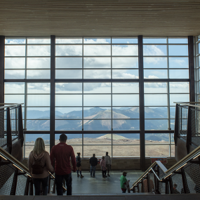 grand view from second floor of indoor viewing platform. floor to ceiling windows. Majestic mountains outside
