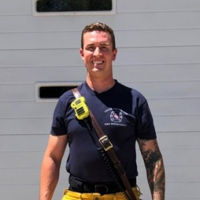 medical calls uniform: yellow firefighting pants, navy tshirt, radio carrier