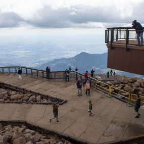 upper and lower outdoor viewing platforms. People milling about and looking out over the landscape below.
