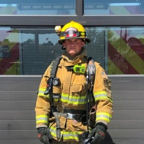 Structure firefighting gear: yellow firefighting uniform and helmet covers head to toe