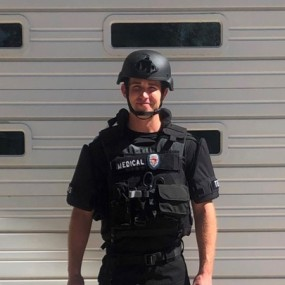 firefighter medic in black tactical vest and helmet
