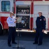 Fire Chief Christian Ontiveros of Nuevo Casas Grandes and Colorado Springs Fire Chief Ted Collas in front of a fire engine