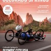 Official Visitors Guide Cover with athlete hand-cycling and Garden of the Gods in the background