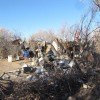 large piles of trash in an illegal camp