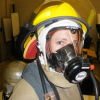 Image of a teen in fire fighting equipment